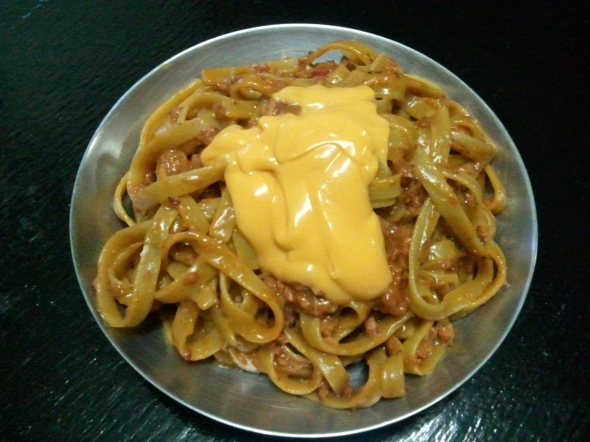 Trying my spaghetti with melted, but rich cheese, on top.