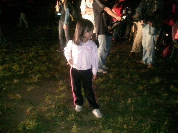 A little girl striking a pose.