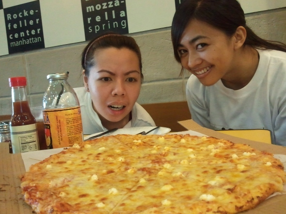 Eating cheese pizza with my run mates, after the run.