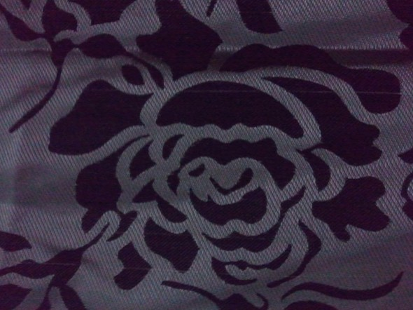 A rose pattern on a curtain. But I seem to see a facial figure. Do you?