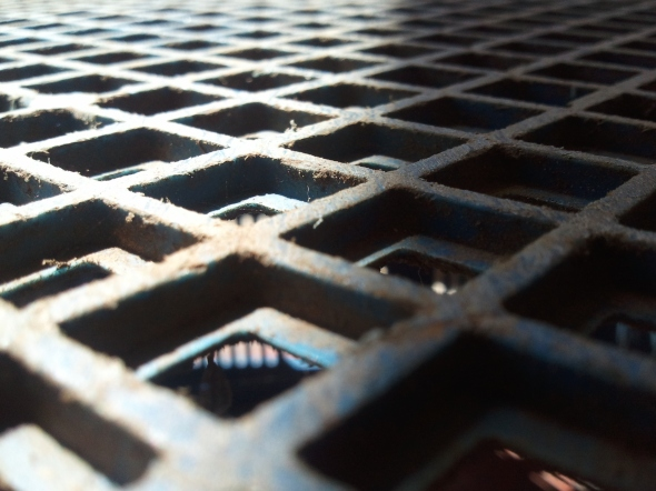 Sophisticated surface up close, plastic crate from afar.